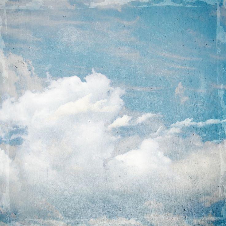 Tekening van een wolkenlucht in blauw en wit