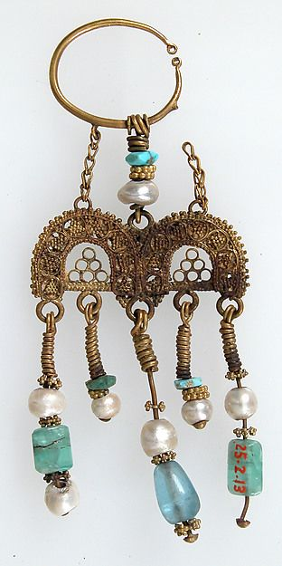 Earring Date: 2nd–3rd century Geography: Made in Kharga Oasis, Byzantine Egypt Culture: Coptic Medium: Gold, semi-precious stones Dimensions: Overall: 3 1/16 x 1 1/4 x 3/16 in. (7.7 x 3.2 x 0.5 cm) Classification: Metalwork-Gold Earring | Coptic