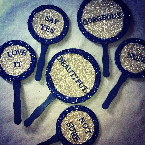Wedding dress shopping paddles for bridal shop fun!  These paddles are a fun way to make your dress shopping more interactive.  Friends and family get to hold sparkly paddles and it makes wedding dress shopping more of an event!  Say yes to the dress