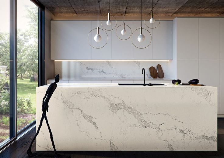A marble-inspired design, Statuario Maximus is a bold new surface, featuring intricate warm grey veins that sweep across a soft white base, enriched by delicate background veins. Caesarstone is an engineered quartz stone, ideal for virtually any interior surface including kitchens and bathrooms.