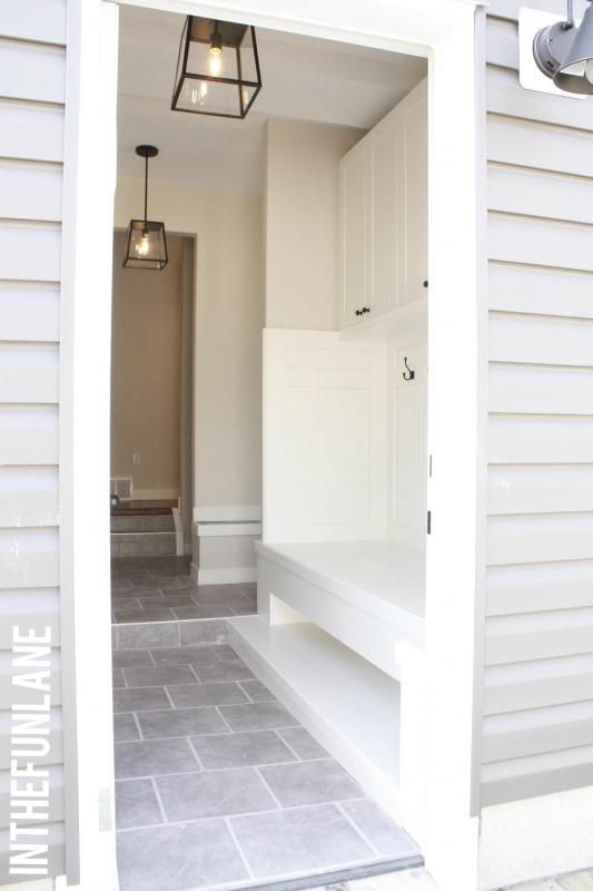 Mudroom entrance. Love the stone floor, color scheme and built in bench.