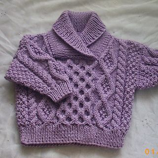 This is a knitting pattern for a sweet little sweater which has a cross-neck shawl collar. Perfect for boys or girls!