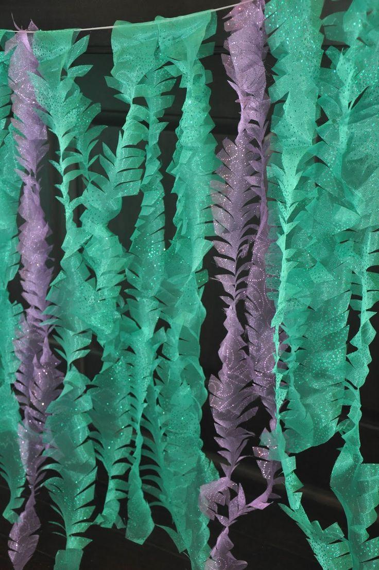 "fabric seaweed - cut fabric in 3"" wide strips, snip edges in V shape.   2yd glitter organza in Jade, 2yd glitter organza in Dewberry, and 3yd matte nylon tulle in Jade."