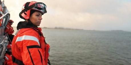 Coast Guard member standing watch.