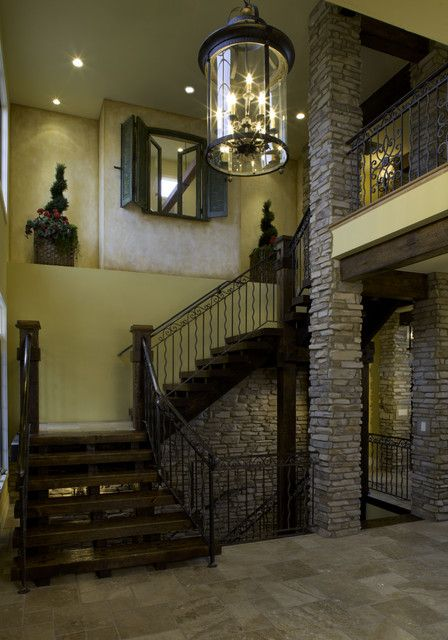: Old Fashioned Mediterranean Home Hall Displaying Staircase With Wood Steps And Classic Glass Italian Chandelier