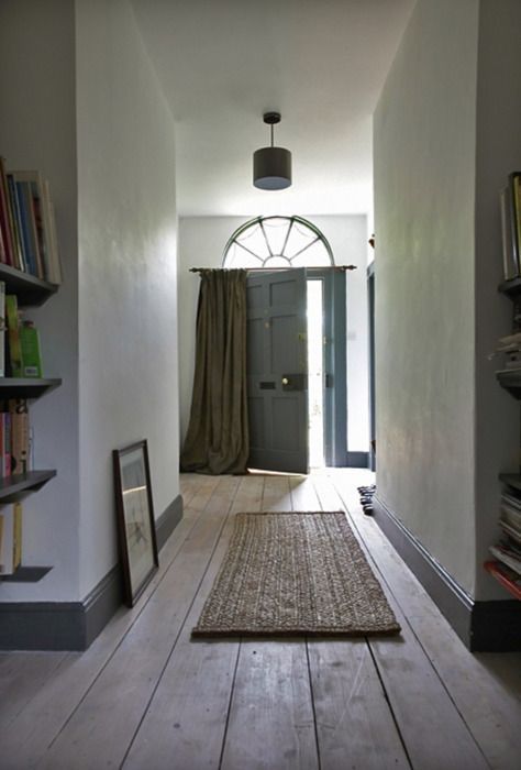 love it all...the grey paint, exposed boards, curtain, fanlight and mat!