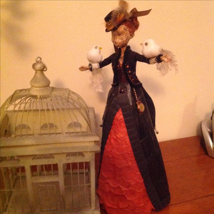 My repurposed Anna doll, transformed into a Steampunk beauty using a bottle base (to give her height) magazine and scrap papers and fabric offcuts and other stuff lying around. I love her!