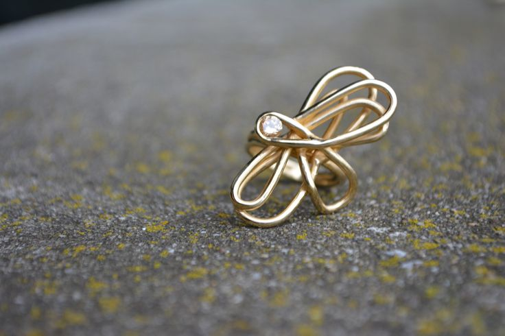 ring from golden wire and champagne diamond