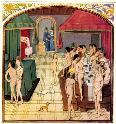A medieval illumination of a public bath, with men and women enjoying a dinner party in the tub, and the nearby beds suggest that this is also a brothel. -apartmenttherapy