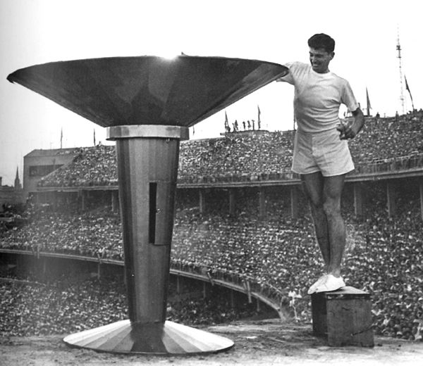 Olympic Cauldron - Melbourne, Australia 1956 Summer Olympic Games Ron Clarke lighting flame- a few years later he would set a number of world records over 3m/5k & 6m/10k as well as winning an Olympic bronze