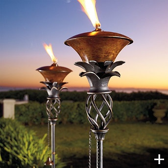 outdoor torch lighting. frontgate pineapple torch to light walkways pool areas and lounging patios the antique brass reservoir is fitted with a sunken opening that minimizes outdoor lighting d