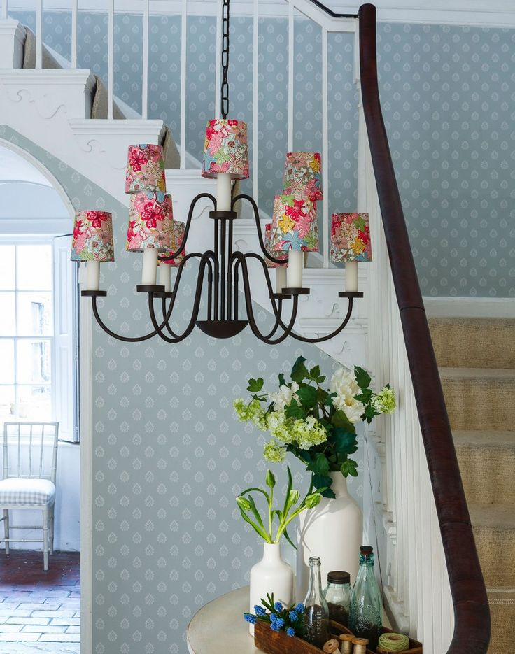 When it comes to choosing accessories for your hallway, pick white ceramics in chunky modern shapes, which are perfect for displays of spring flowers. The floral lampshades on the chandelier add another welcome injection of spring