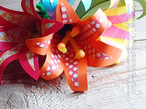 Tutorial for making beautiful tropical paper flowers using scrapbook paper and card stock. Love these! From Amanda Formaro of Crafts by Aman...