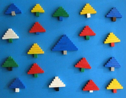 """A partir d'un modèle en photo , les enfants devaient retrouver la façon d'assembler les pièces pour obtenir ces """"sapins"""" Voici les constructions des grands du groupe des rouges: Plongée sur une table en plein travail:"""