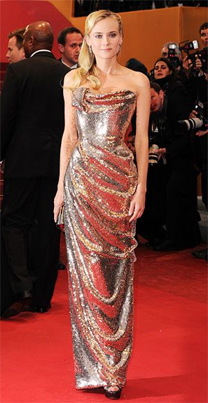Cannes Film Festival 2012: See the Fashion!  Diane Kruger  Diane Kruger glittered on the red carpet in a sequined rose gold Vivienne Westwood gown with a built-in corset. She accessorized with side-swept waves and a Jimmy Choo clutch.