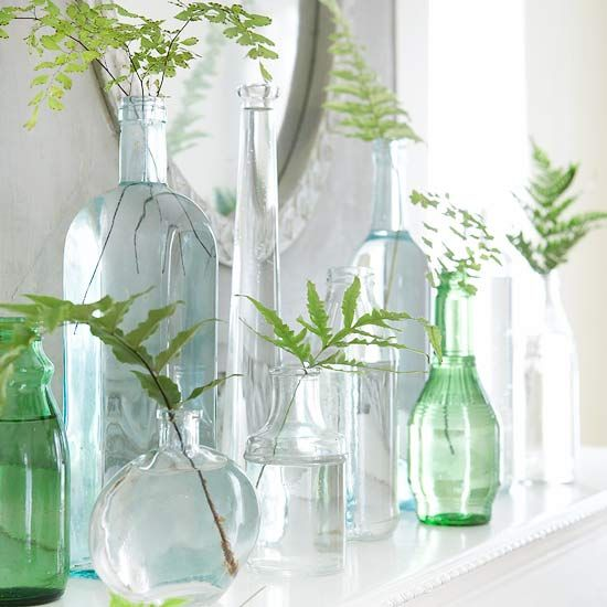 simple mantle decor. Fern sprig in varying glass vases.