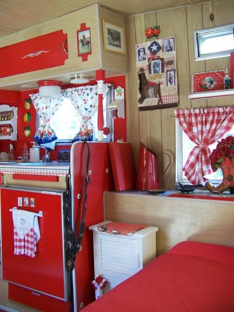 red interior of a tiny trailer