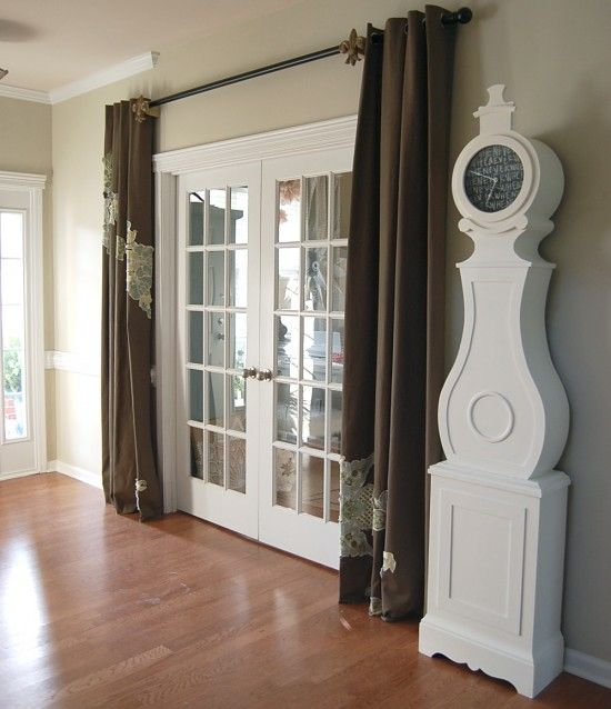 Glass door with curtains idea for front hall change out for Curtains for french doors ideas
