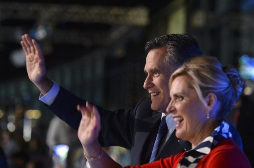 U.S. Republican presidential candidate Mitt Romney and his wife Ann wave during the opening ceremony of the London 2012 Olympic Games at the Olympic Stadium July 27, 2012.