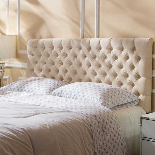 There's something so inviting about an upholstered headboard — and particularly a tufted headboard, which combines the coziness of an upholstered headboard with a touch of old-world glamour. If you'd like to add a bit of luxury to your bedroom, check out this roundup of 11 beautiful headboards for any budget: Eudia Queen Upholstered Panel Headboard at Wayfair