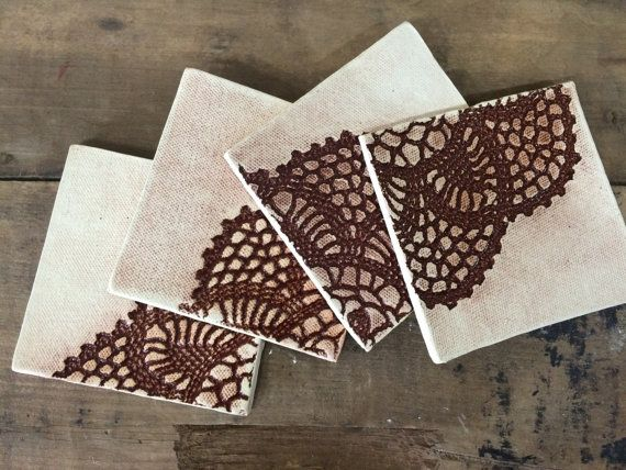 Hand made clay coasters with vintage doily impression. Glaze is only in the pattern so they will absorb any water from sweaty glasses. First
