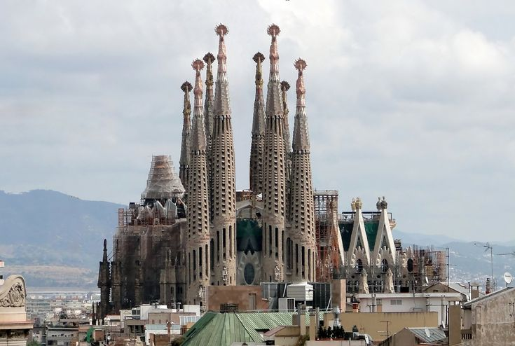 The Sagrada Familia is a Roman Catholic church in Barcelona. The church was designed by Antoni Gaudí, and he combined Gothic and Art Noveau.