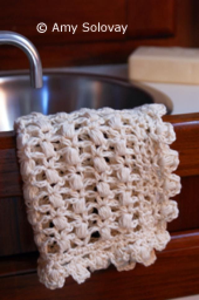 Crochet Gorgeous Dishcloths with These 15 Free Patterns: Puff Stitch Lace Crochet Dishcloth Pattern
