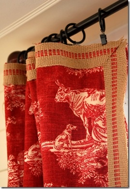 Jute drapery border. What about inexpensive upholstery strapping as a border.. Living room..