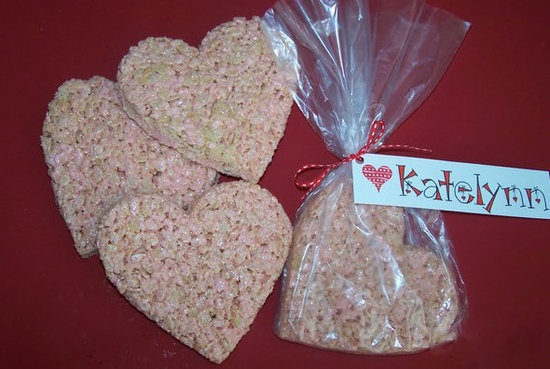 "Krispie Treat Hearts: ""A few drops of almond extract and some red food coloring will have them flocking to be your sweetheart."" –Tinkerbell via Food.com  Get Tinkerbell's Krispie Treat Hearts recipe>>  Find more ideas on our Edible Valentines Pinterest board.  Photo Source: Food.com via  Tinkerbell"