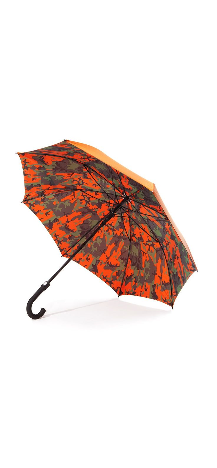 Camo Umbrella / Made witha durable and lightweight shell, this automatic umbrella opens up to reveala camo-printed underside. #fw17