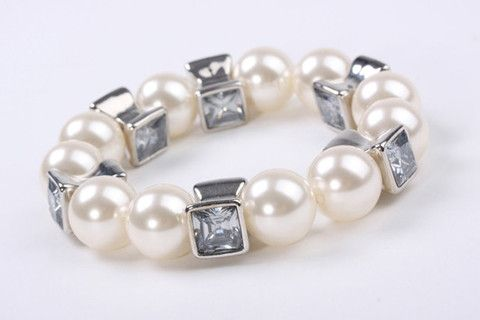 Boho Pearl Stretch Bracelet Silver: Bold and luxurious, this bracelet creates chic and trendy look both day and night. 10mm chunky acrylic lustre pearls with square crystal look beads. Elastic stretch for a perfect fit. $79.90