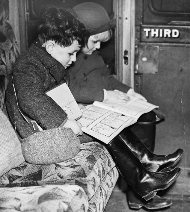 In December 1939 the second official evacuation scheme started. These children reading the Nipper annual are part of a group leaving for Devon and Christmas in new surroundings.