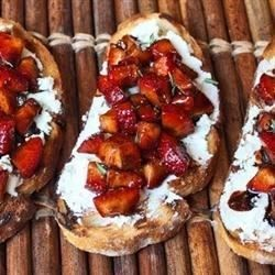Charred Italian bread is topped with creamy goat cheese and a mixture of strawberries and balsamic vinegar. This makes the perfect start or end to an Italian feast.