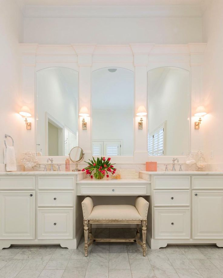 Images Photos Framed mirrors in a bathroom aren ut always the answer These frameless mirrors were cut with an arch on the top and a small bevel around them