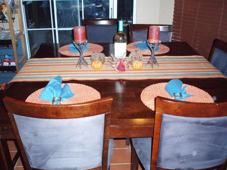 This is my Square, dark oak, bar height dining set. It's my favorite thing. I never planned to pick a color but the blue is actually very deep and here, the table is ready for Thanksgiving dinner. Courtesy of wedding gift certificates.