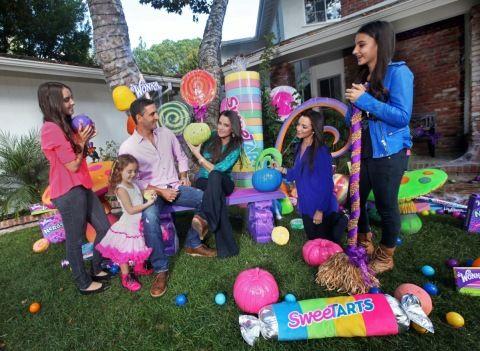 Kyle Richards, husband Mauricio Umansky and daughters, Farrah, Alexia, Sophia, and Portia, unveil their SweeTARTS Halloween house on Tuesday...