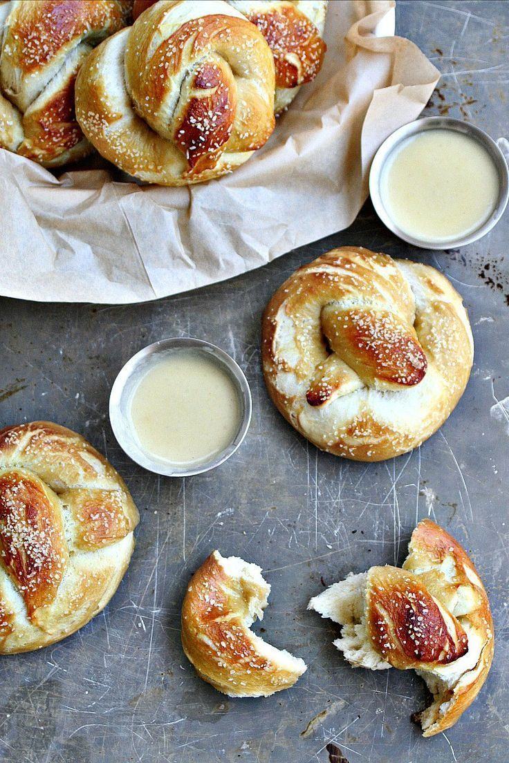 Beer Pretzels with Drunken White Cheddar Sauce. These golden pillow-y beer pretzels are salted and hardened on the outside, but soft and chewy on the inside. Served with a white cheddar beer sauce, it's perfection all around.   | Killing Thyme #beer #pretzels #appetizer