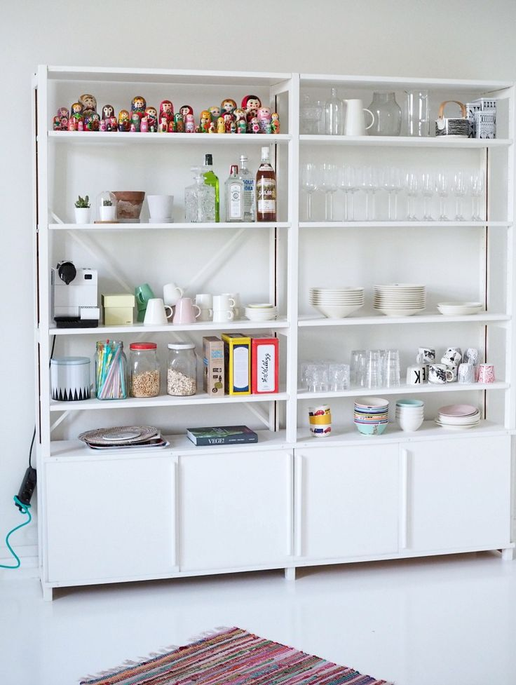 IKEA Ivar shelves, repainted white.