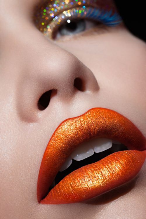 beautiful orange lip. a perfect orange lipstick is hard to find. not every undertone can wear it.