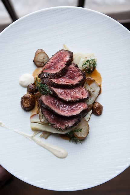 Chef Erick Williams of MK - Chicago, IL   StarChefs.com Grilled Bison Ribeye, Salt-roasted Sunchokes, Poached Fennel, Redwine Sauce, Confit of Garlic. Personally, I would not do the Poached Fennel with this, it sounds awful, I would do a grilled fennel instead, if I was wedded to the whole fennel idea.