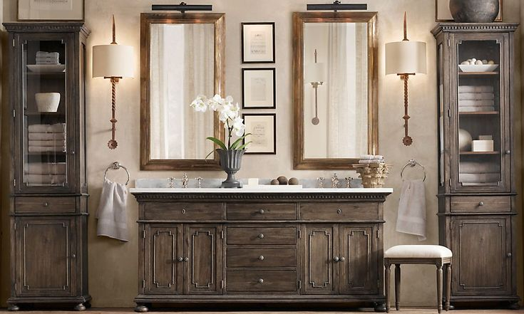 This bathroom i love! The cabinets are unique, the stain is brown with a gray undertone. The over-sized sconces are beautiful! The separation of the linen towers adds a furniture detail. Love-love love!