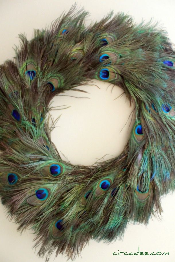 Peacock wreath. -- I think I've stopped breathing! This is simply gorgeous. The post is also a tutorial on how to make this; the blogger used 200 leftover feathers from a wedding.