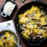 Rosted spaghetti squash recipe in the oven, then cooked with sausage and parmesan cheese. This is the best spaghetti squash recipe and how to bake it