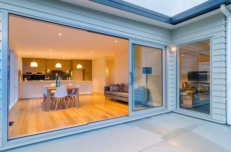 Stunning indoor outdoor flow in this modern home where  traditional exterior is created using Linea Weatherboard