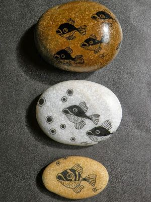 I like this understated art on rocks with plenty of space for the rock to show through. Looks great with a coat of acrylic.