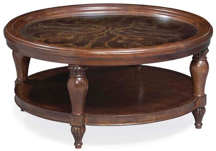 Round glass topped cocktail table with gallery rail and - Woodbridge home designs avalon coffee table ...
