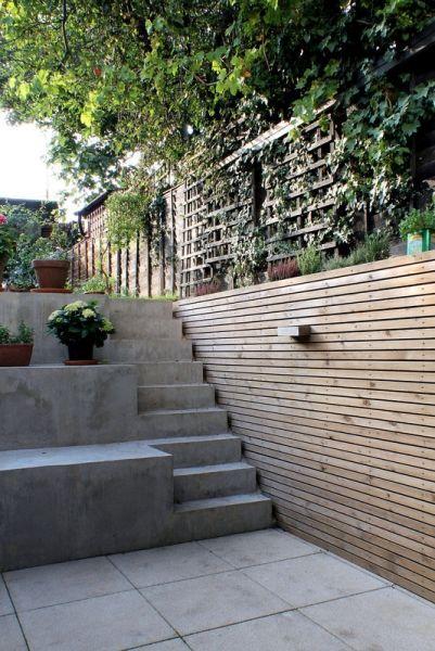 Milton - New external terrace area with cast concrete steps leading to garden.