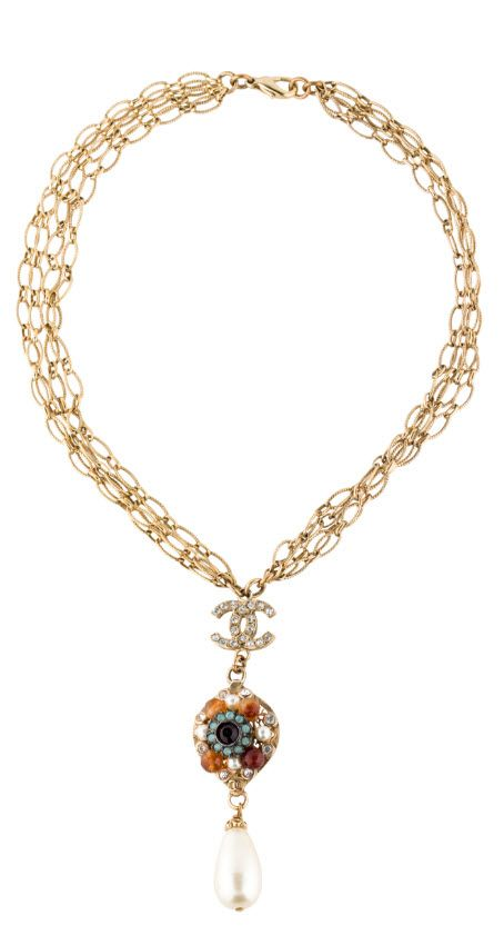 CHANEL CRYSTAL AND FAUX PEARL CC LAVALIER NECKLACE $1,095.00 shop now http://rstyle.me/n/bqge9zrm5w Gold-tone Chanel multistrand chain-link necklace with crystal embellished interlocking CC logo pendant featuring faux pearls, crystal and bead embellishments with faux pearl drop-bead and lobster clasp closure. From the Fall 2005 Collection. Includes box.