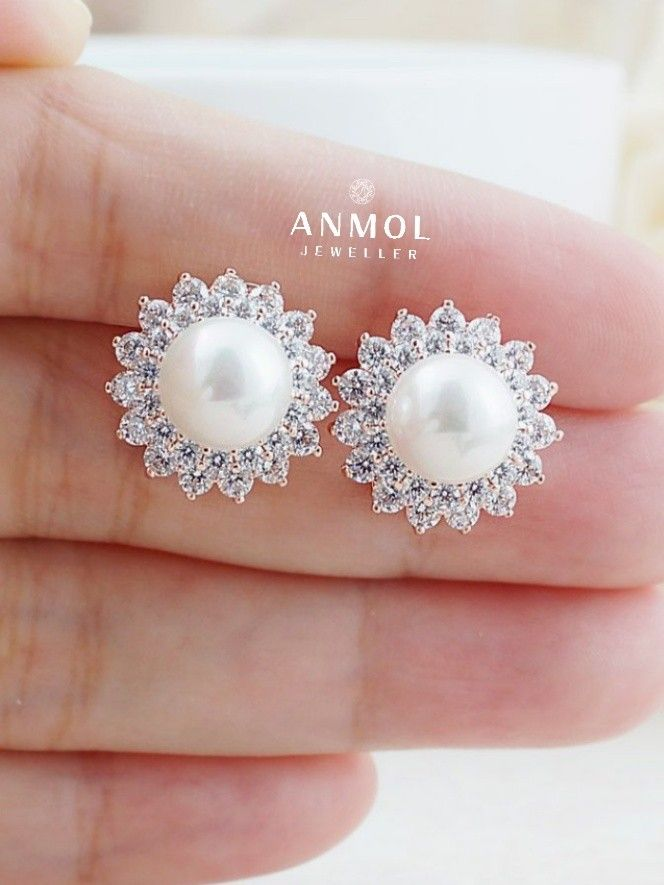 Simplicity of pearls with graceful diamonds. Pair of stud with all its beauty at one place. #anmol_jeweller  #gold #diamond #artwork #earing #tops #wearable #jewel #jewellery #stylish #cute #royal #luxury #designer #beautiful #fashioable #pearl #stone #naturalpearl #gorgeous #classy  For queries call or watsapp:9910401704.  To place order mail us at:Anmol.jeweller01@gmail.com