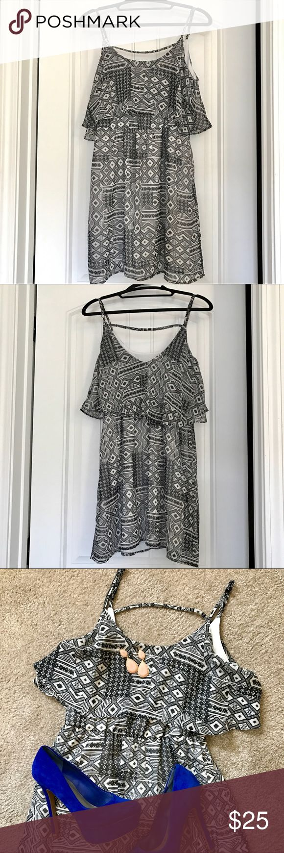 Nordstrom Black & White Tribal Sun Dress This sun dress is perfect for multiple occasions! Wear it to the beach, pair it with some bright heels for a wedding, or put on a cardigan and wear it to church! Hits about 2-3inches above the knee for a shorter person. Comfy and breathable...plus...it has pockets! Fits true to size. 100% Polyester. Machine wash cold and hang to dry. Nordstrom Dresses Mini